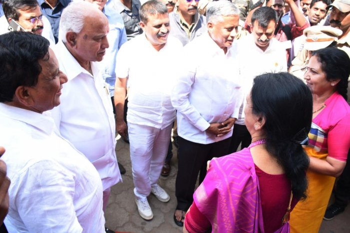Chief Minister B S Yediyurappa speaks to MLC Veena Acchaiah and expresses his regrets over the violation of protocol during the foundation stone laying programme in the premises of government maternity hospital in Madikeri on Monday. DH Photo