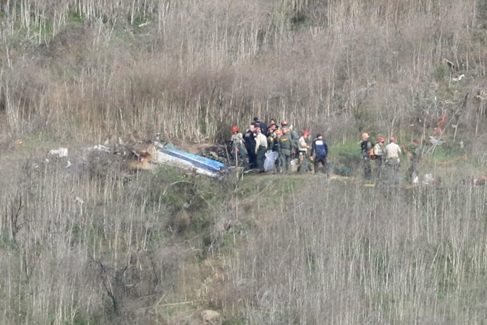 Witnesses told local media the helicopter appeared to be flying very low and seemed to struggle before it slammed into a hillside. (Credit: AFP Photo)