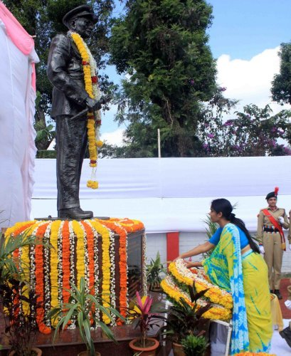 Deputy Commissioner Annies Kanmani Joy pays floral tributes to the statue of Field Marshal K M Cariappa in Madikeri on Tuesday.