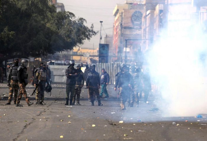 Iraqi security forces clash with protesters during anti-government demonstrations in al-Khillani Square off central Baghdad's Sinak bridge which links the Iraqi capital's Green Zone with the rest of the city on January 28, 2020