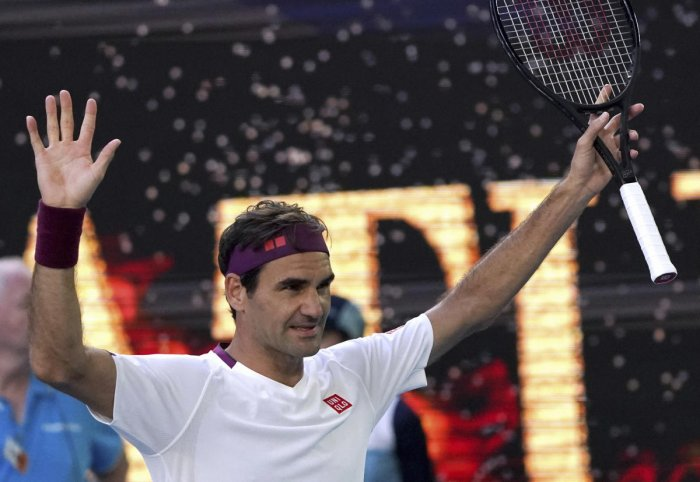 Switzerland's Roger Federer reacts after defeating Tennys Sandgren of the U.S. in their quarterfinal match at the Australian Open tennis championship in Melbourne
