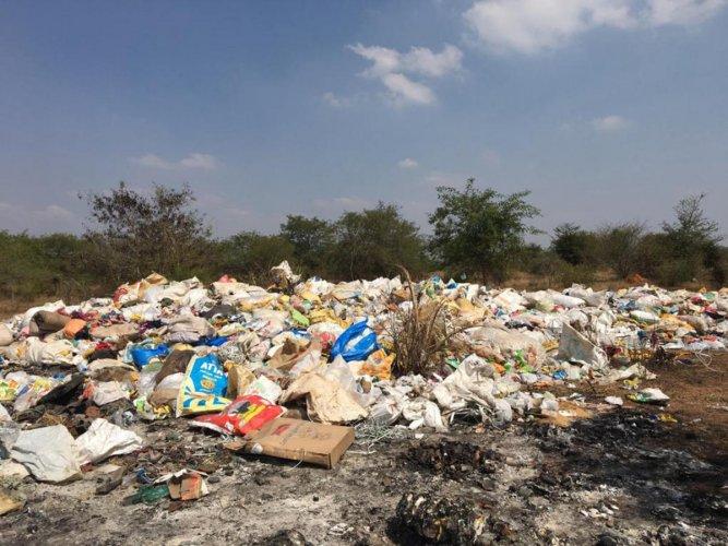 Bio-medical waste dumped at the Adakanahalli Industrial Area in Nanjangud taluk of Mysuru district.