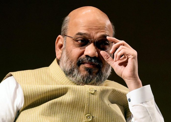 """""""The Union Home Minister exhorted the members (of the council) to resolve the issues relating to forest clearance and provide brick-and-mortar banking facility within 5-km radius in each village, particularly in Naxal areas,"""" a Press Information Bureau (PIB) release said. Credit: PTI Photo"""