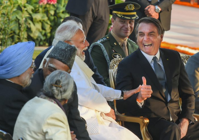 Prime Minister Narendra Modi shares a light moment with Brazilian President Jair Bolsonaro (C) as President Ram Nath Kovind looks on, during the 'At-Home' reception, organised on the occasion of Republic Day, at Rashtrapati Bhawan in New Delhi, Sunday, Jan. 26, 2020. (PTI Photo)