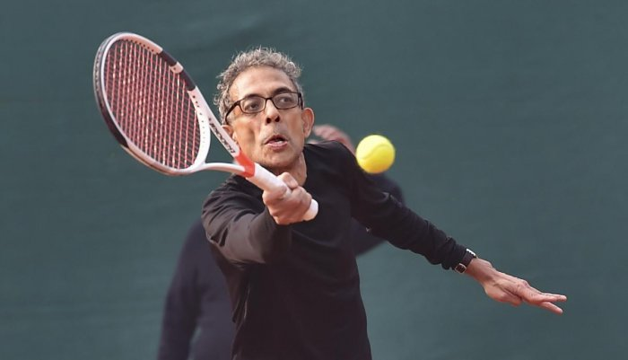 Nobel laureate and economist, Abhijit V Banerjee, playing tennis at a south club in Kolkata, Tuesday, Jan. 28, 2020. (PTI Photo)