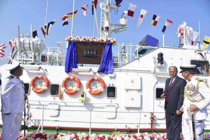 Chief Secretary T M Vijay Bhaskar unveils the plaque at the symbolic commissioning of Indian Coast Guard's Interceptor Boat C 448 at New Mangalore Port in Mangaluru on Wednesday.