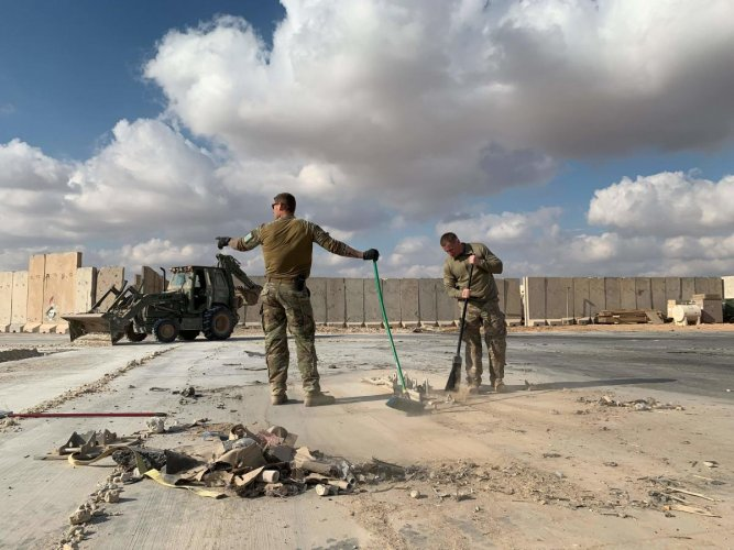 A file picture taken on January 13, 2020 during a press tour organized by the US-led coalition fighting the remnants of the Islamic State group, shows US soldiers clearing rubble at Ain al-Asad military airbase in the western Iraqi province of Anbar. Credit: AFP File Photo