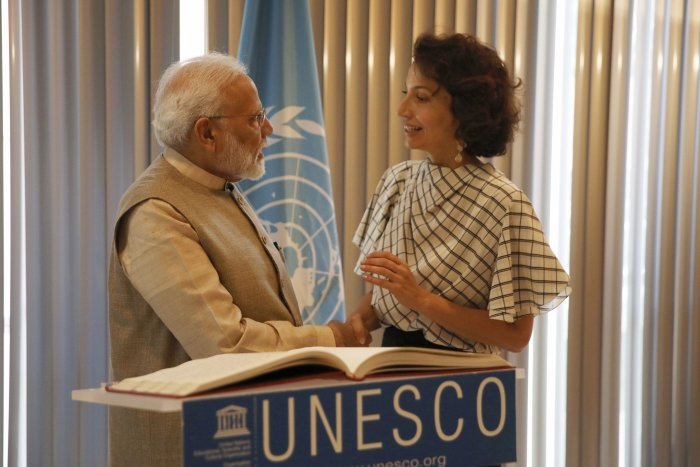 Indian Prime Minister Narendra Modi shakes hands with UNESCO'S Director-General Audrey Azoulay. (Photo Credits: PTI)