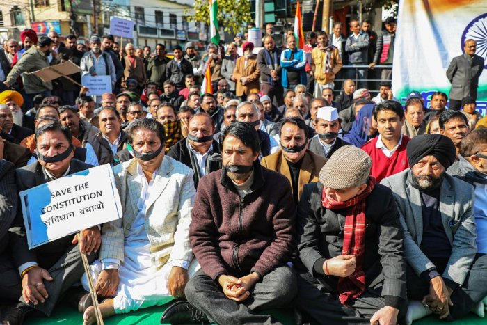 JKPCC Chief  G A Mir (sitting at centre in the front row) along with other senior Congress leaders take part in a demonstration to save constitution after paying homage to Mahatma Gandhi on his 72nd death anniversary