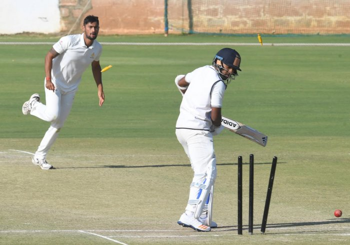 Karnataka paceman Ronit More (left) claimed 6/32 to fashion Karnataka's 10-wicket win over Railways in their Ranji Trophy match in New Delhi on Thursday. DH FILE PHOTO