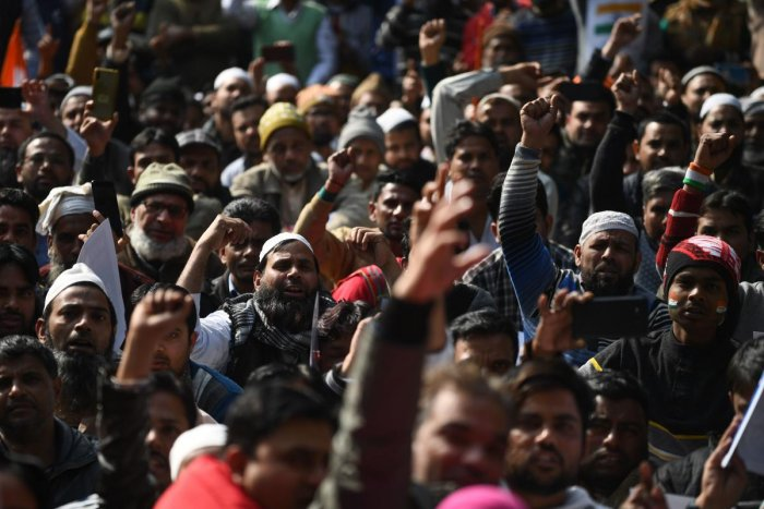 Protesters from Shaheen Bagh shout slogans as they take part in a demonstration against India's new citizenship law at Jantar Mantar