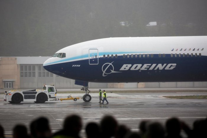 A Boeing 777X airplane returns from its inaugural flight at Boeing Field in Seattle, Washington on January 25, 2020. (AFP Photo)
