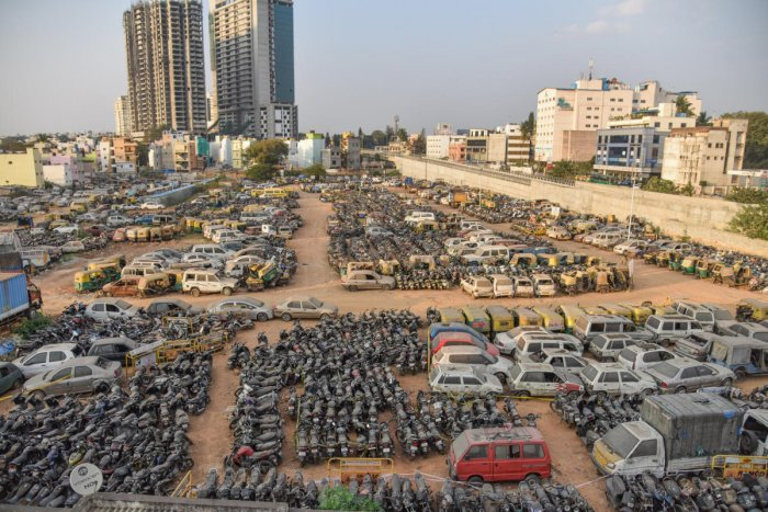 Seized and unclaimed vehicles dumped by the police at the Jakkarayana Kere. DH photo/S K Dinesh