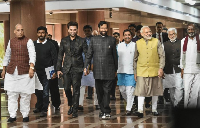 Prime Minister Narendra Modi with (L-R) Defence Minister Rajnath Singh, Lok Janshakti Party chief Chirag Paswan, Union minister Ram Vilas Paswan, Parliamentary Affairs Minister Pralhad Joshi and others after an all-party meet ahead of the Budget Session,