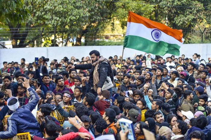 Students carry a Tricolour during their protest march against the Citizenship Amendment Act and National Register of Citizens (NRC), near Jamia Millia Islamia university in New Delhi, Thursday, Jan. 30, 2020. (PTI Photo)