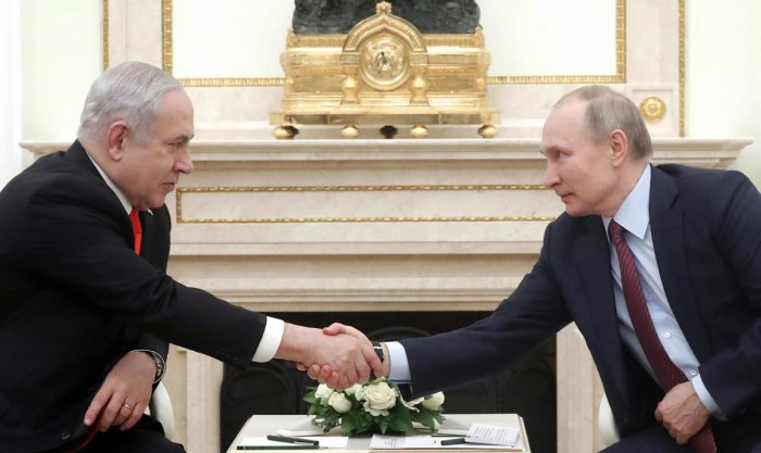 Russian President Vladimir Putin, right, shakes hands with Israeli Prime Minister Benjamin Netanyahu during their meeting in the Kremlin in Moscow
