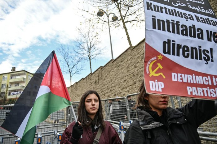 "Protester hold a Palestine flag and a placard reading ""Resistance until libaration"" as they take part in a demonstration in front of the US consulate to protest against the US peace plan in Istanbul, on January 29, 2020. Credit: AFP Photo"