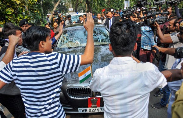 Students of various colleges and universities stage a protest in front of West Bengal Governor Jagdeep Dhankhar's car on his arrival at the Calcutta University to attend its annual convocation ceremony, in Kolkata, Tuesday, Jan. 28, 2020. (PTI Photo)