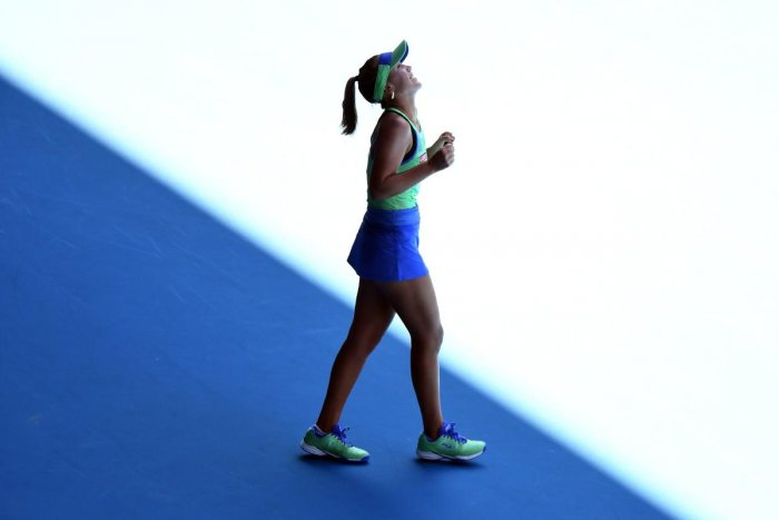 Sofia Kenin of the US celebrates after beating Australia's Ashleigh Barty during their women's singles semi-final match on day eleven of the Australian Open tennis tournament in Melbourne