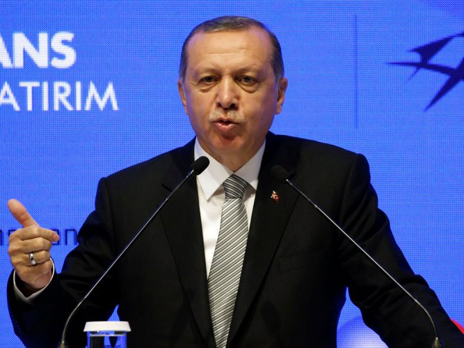 """He also said Turkey """"could not stand by as mere spectators as new threats come towards our borders""""."""