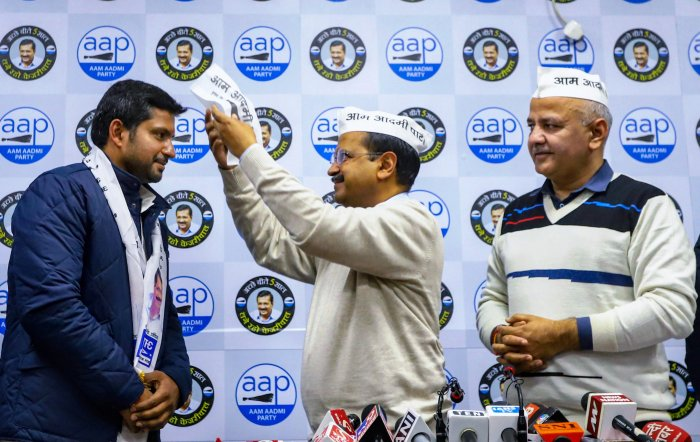 Delhi CM Arvind Kejriwal welcomes Vinay Mishra, son of former Congress Parliamentarian Mahabal Mishra after the former joined AAP party in the presence of Deputy CM Manish Sisodia and others, in New Delhi, Monday, Jan. 13, 2020. (Credit: PTI Photo)