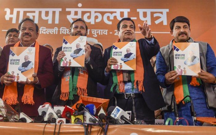 Union ministers and BJP leaders Nitin Gadkari (C-R), Prakash Javadekar (C-L) and Harsh Vardhan (L) along with Delhi BJP President Manoj Tiwari (R) release the 'BJP Sankalp Patra for Delhi Assembly Elections 2020, in New Delhi, Friday, Jan. 31, 2020. (Credit: PTI Photo)