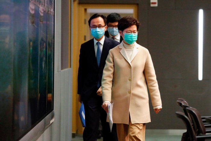 Hong Kong Chief Executive Carrie Lam wears a mask as she arrives to a news conference in Hong Kong
