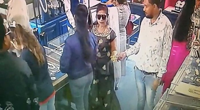 A video grab of the suspects pocketing the gold chain at the exhibition.