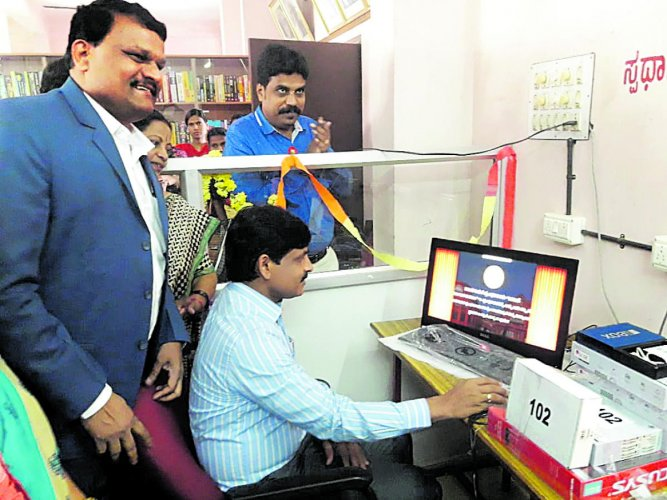 Udupi Deputy Commissioner G Jagadheesha inaugurates Digital Library Service, a first-of-its-kind initiative in the country, at Zilla Panchayat building in Udupi on Thursday.