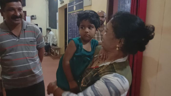 Anwi was reunited with her parents at Agumbe police station in Shivamogga district. DH Photo