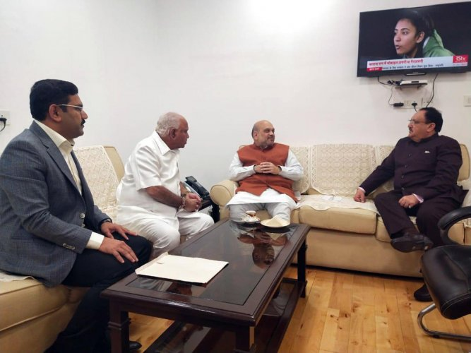 Chief Minister B S Yediyurappa holds talks with Union Home Minister Amit Shah and BJP national president J P Nadda, in New Delhi on Friday.
