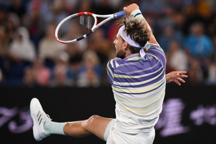 Austria's Dominic Thiem hits a return against Serbia's Novak Djokovic during their men's singles final match on day fourteen of the Australian Open tennis tournament in Melbourne. (AFP Photo)