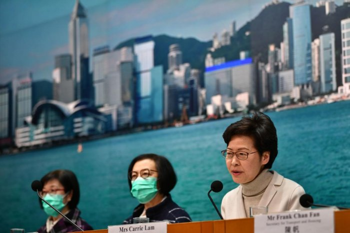 Hong Kong's Chief Executive Carrie Lam (R) speaks during a press conference in Hong Kong on February 3, 2020. AFP