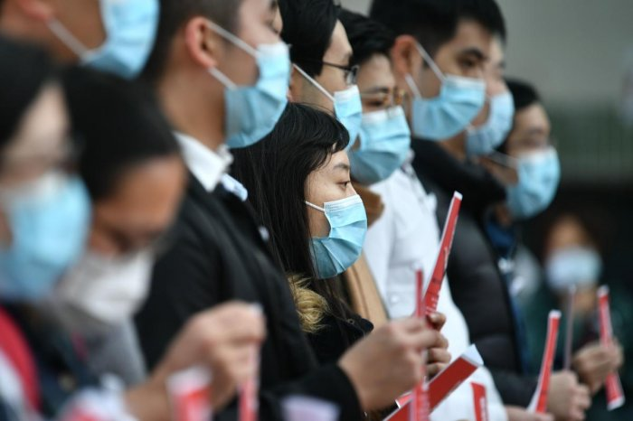 Local medical workers hold a strike near Queen Mary Hospital as they demand the city close its border with China to reduce the coronavirus spreading, in Hong Kong on February 3, 2020. (AFP Photo)