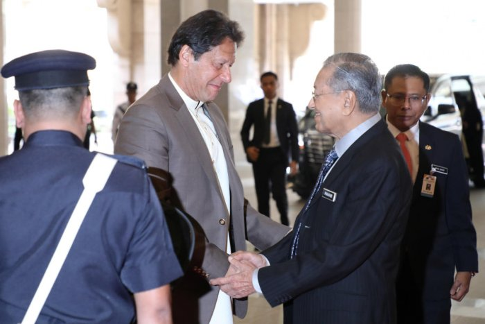 Pakistan's Prime Minister Imran Khan shakes hands with Malaysia's Prime Minister Mahathir Mohamad during his arrival at Malaysia Prime Minister Office in Putrajaya