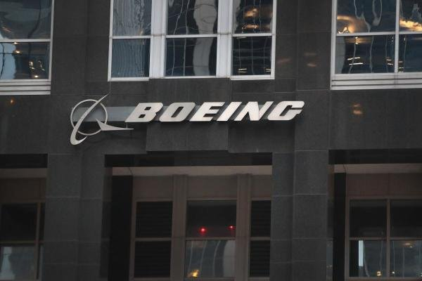 The company logo hangs above an entrance to the headquarters of The Boeing Company on January 29, 2020 in Chicago, Illinois. (Getty Images)