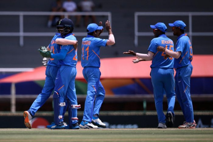 India's Dhruv Jurel (2nd L) celebrates with teammates after running out Pakistan's Qasim Akram during the Semi-Final of the ICC Under-19 World Cup. (AFP Photo)