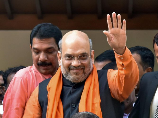 """Shah congratulated Modi """"for such an unprecedented decision"""" that strengthens social harmony. Credit: PTI Photo"""