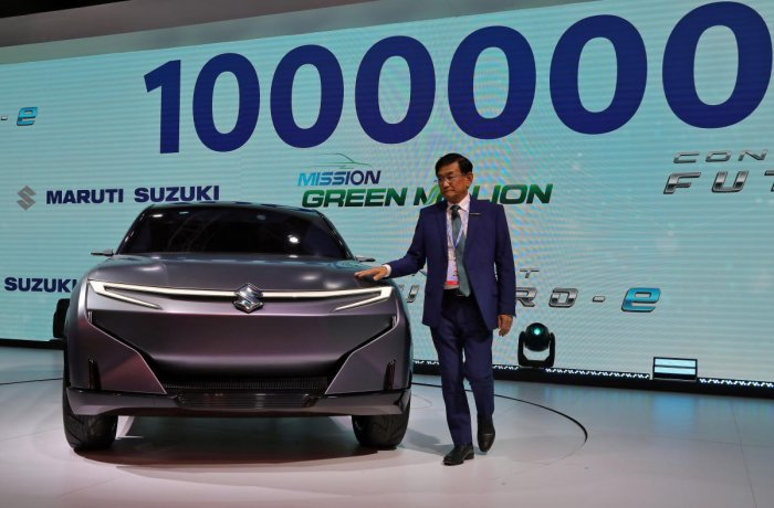 Kenichi Ayukawa, Chief Executive Officer of Maruti Suzuki India Ltd., poses with concept Futuro-e car after it was unveiled at the India Auto Expo 2020 in Greater Noida. Credit: Reuters Photo