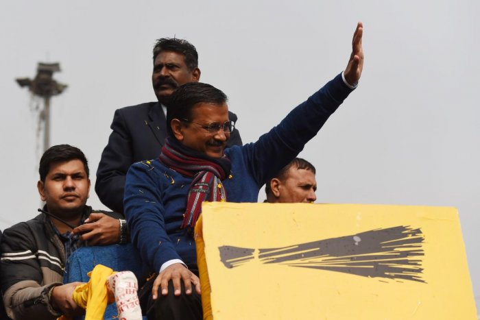 Chief Minister of Delhi Arvind Kejriwal (C) waves to his supporters during a road show for the upcoming Delhi Legislative Assembly election, in New Delhi on January 28, 2020. (AFP Photo)
