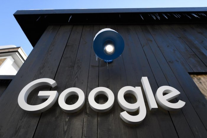 A Google logo is seen on the brand's stand ahead of the annual meeting of the World Economic Forum (WEF) in Davos, on January 20, 2020. (Photo by Fabrice COFFRINI / AFP)