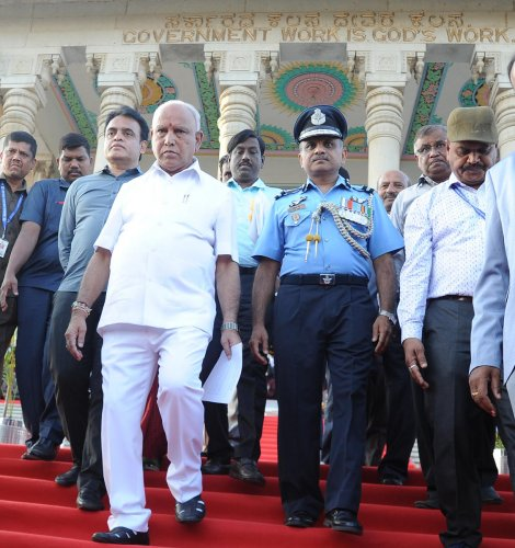Chief Minister BS Yediyurappa, Deputy Chief Minister CN Ashwath Narayan, along with officials and defence personnel, at Vidhana Soudha in Bengaluru on Tuesday after a photo-op with NCC cedits who attended the Republic Day parade in New Delhi. DH Photo/Pus