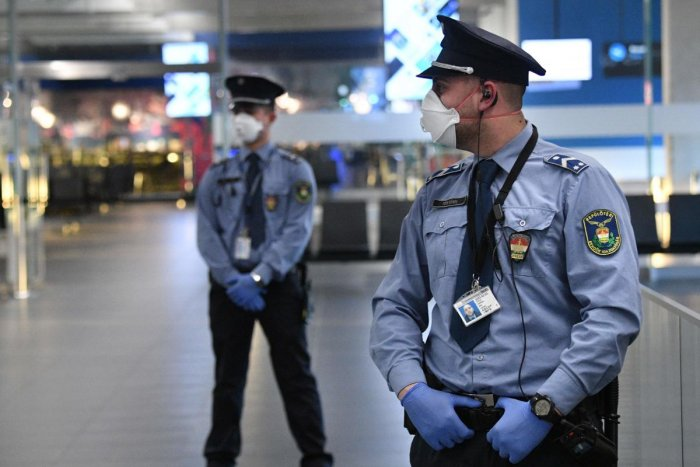 Police officials stand on guard in the hall of Budapest's Liszt Ferenc Airport of on February 5, 2020 during a presentation for the press. (AFP Photo)