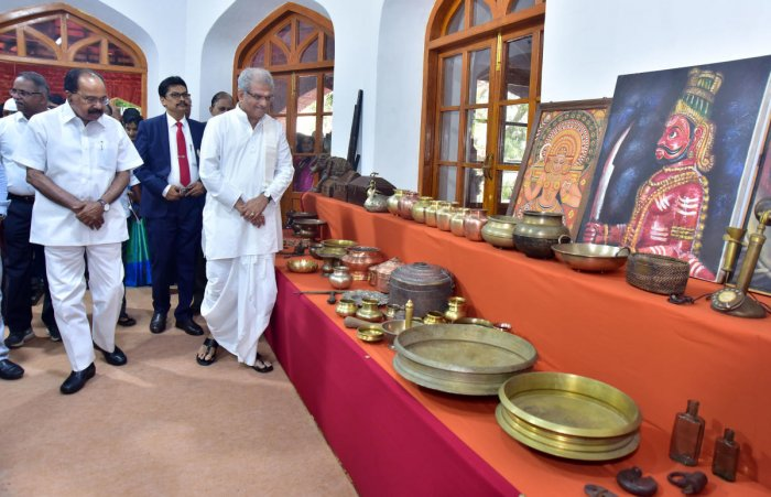 Dharamastala Dharmadhikari D Veerendra Heggade inspects household articles and artifacts of the bygone era at the 150th anniversary celebrations of University College of Mangalore University in Mangaluru on Thursday.