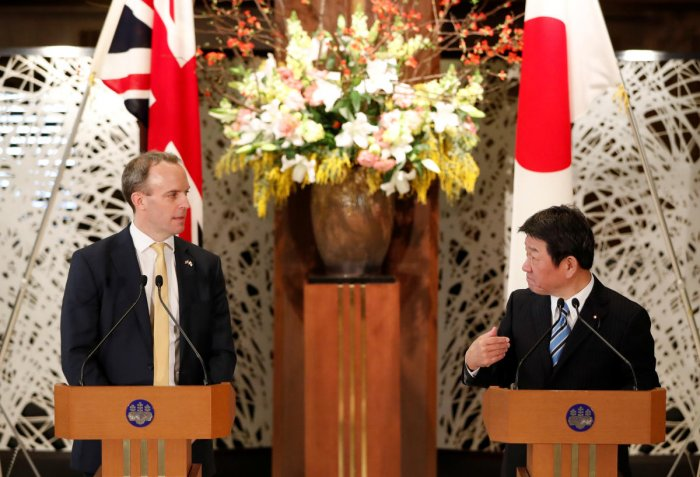 British Foreign Secretary Dominic Raab and Japanese Foreign Minister Toshimitsu Motegi attend their joint news conference after their meeting in Tokyo, Japan. Reuters