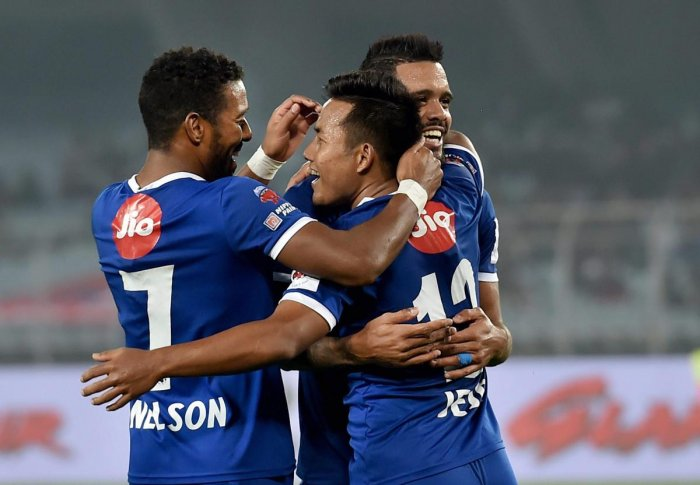 Chennaiyin FC forward Jeje Lalpekhlua(12) jubiliate with his teammates after scoring winning goal for his team against ATK during ISL match in Kolkata on Thursday.Chennaiyin FC won the match by 2-1. (PTI Photo)