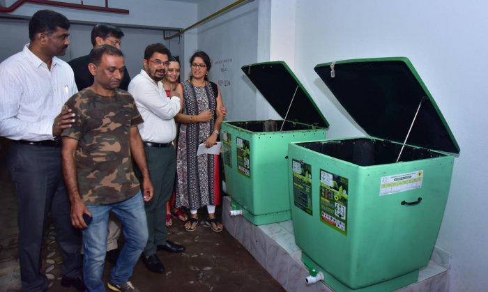 MCC Commissioner Ajith Kumar Hegde Shanady explains about the waste management bin at the apartment where he resides in Mannagudda.