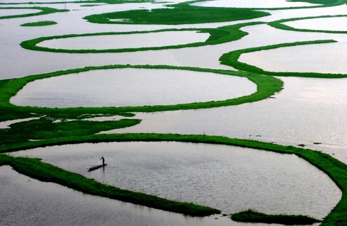 Loktak Lake in Northeast India is an example of a naturally occurring wetland. RAMSAR wetlands are internationally recognised sites.
