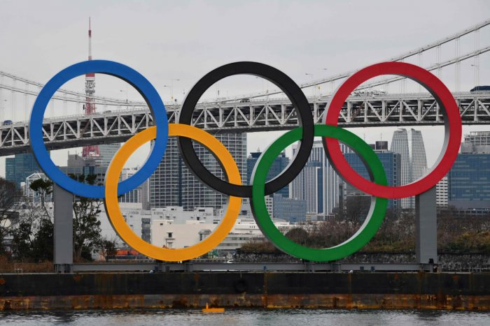 In this file photo taken on January 17, 2020 a large size Olympic Symbol (W32.6m x H15.3m) is brought by a salvage barge to install at Tokyo Waterfront, in the waters of Odaiba Marine Park. AFP