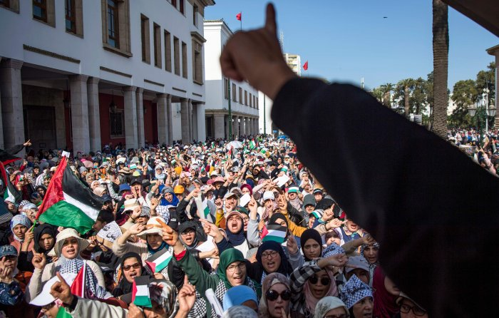 Moroccans wave the Palestinian flag during a demonstration against the US Middle East peace plan in the capital Rabat. (AFP Photo)